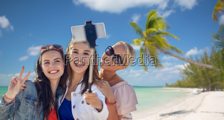 group of smiling women taking selfie