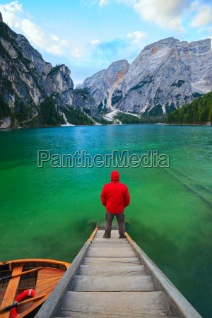 man alone at the braies lake