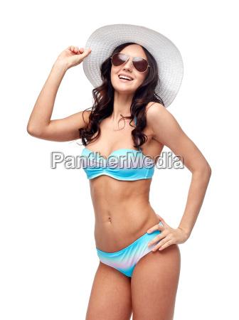 happy young woman in bikini swimsuit