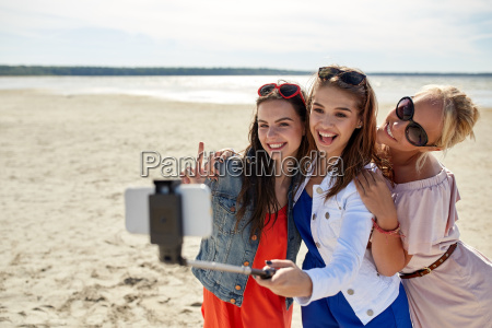 group of smiling women taking selfie