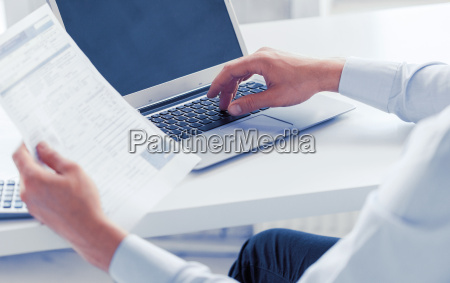 miling businessman working in office