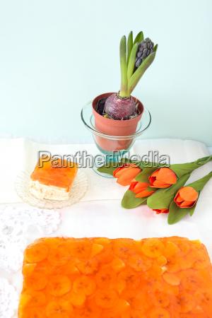 homemade cake with banana orange fruits