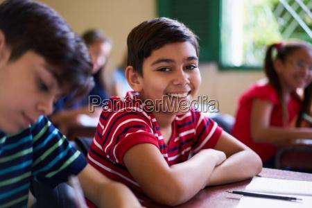 portrait of school boy looking at