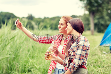 happy women taking selfie by smartphone