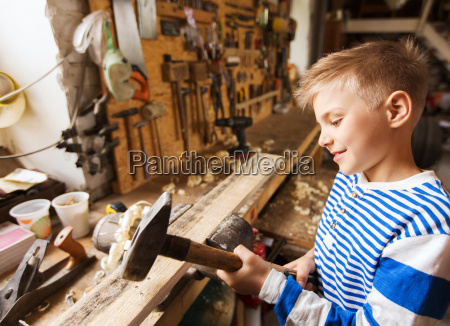 happy little boy with hammer and