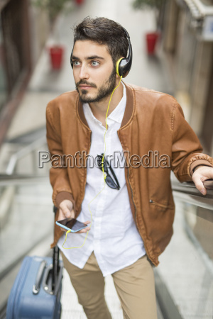 man with cell phone headphones and
