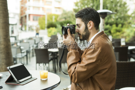 young man taking pictures at outdoor