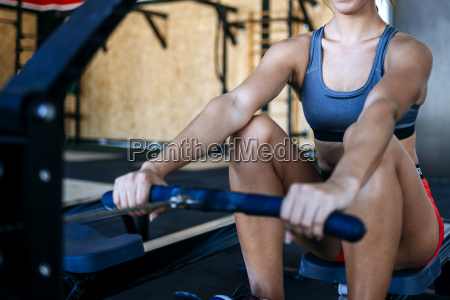 close up of woman exercising with
