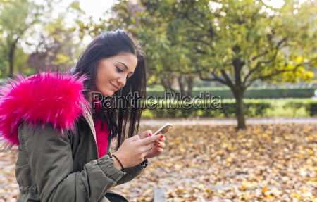 young woman looking on cell phone
