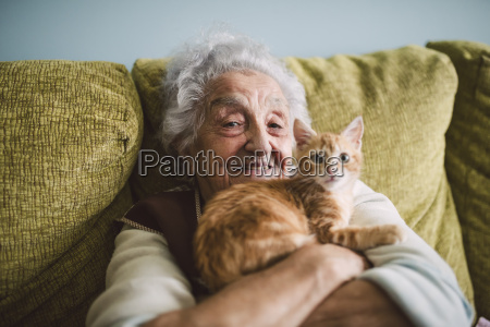 portrait of happy senior woman cuddling