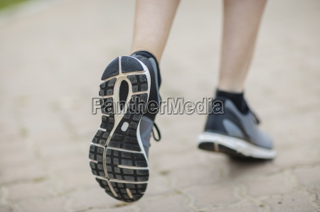 young woman running outdoor close up