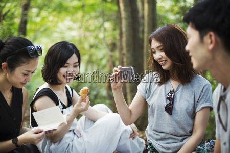 three young women and a man