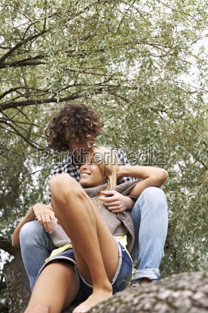 happy young couple sitting on a