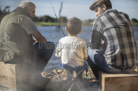 grandfather father and son fishing together