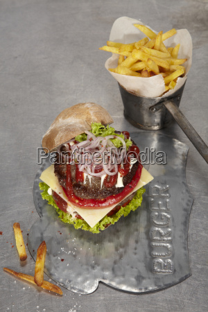 juicy cheeseburger with french fries
