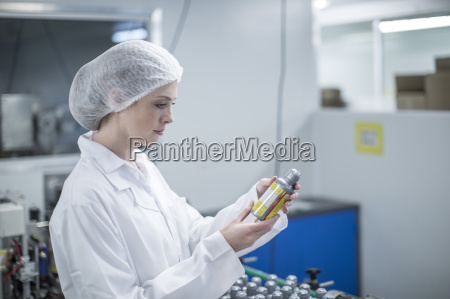 woman in pharmaceutical plant looking at
