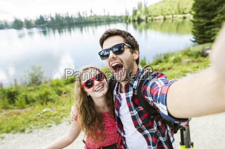 young couple taking selfies on a