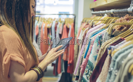 woman using tablet in a boutique