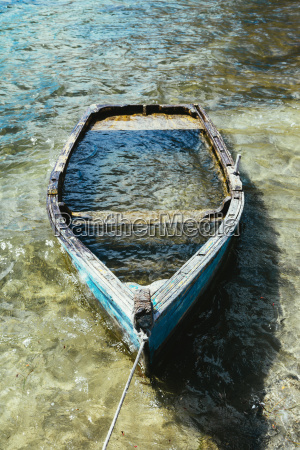 wooden boat sunk in a lake