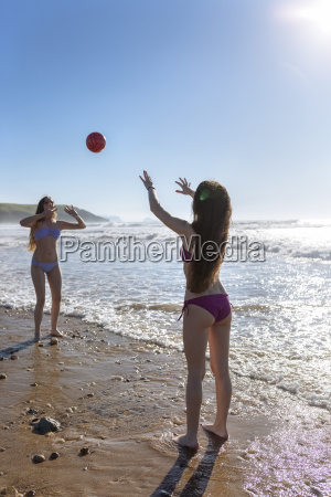 two friends playing with ball on