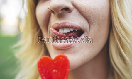close up of young woman licking