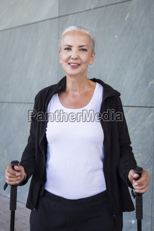 portrait of smiling woman with walking