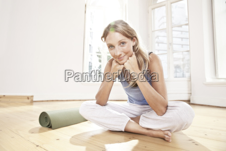yoga woman sitting on floor of