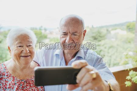 happy senior couple taking a selfie