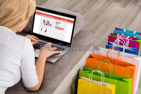 close up of woman shopping online