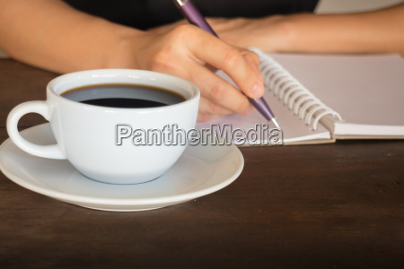 hot cup of coffee on working