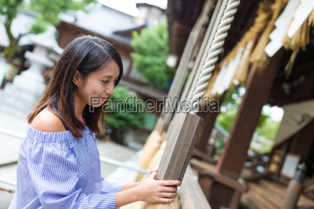woman ringing the bell in japanese