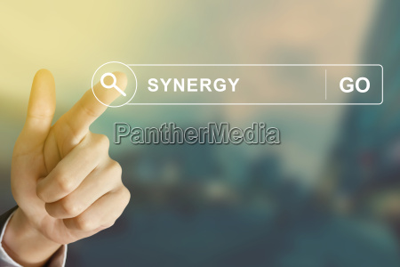 business hand clicking synergy button on