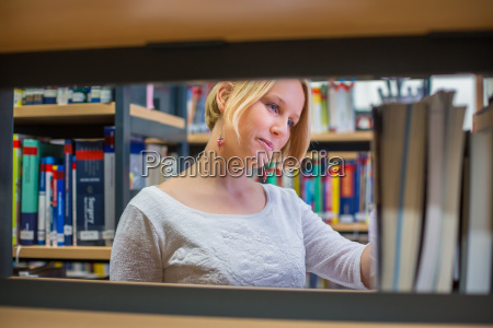 pretty young female student in library