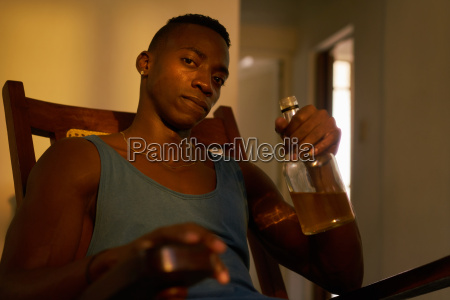 portrait black man drinking alcohol at
