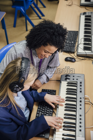 learning keyboard in music lesson