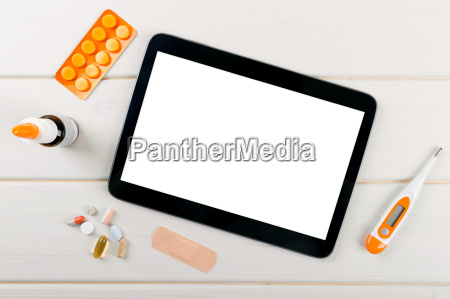 blank digital tablet with medical items