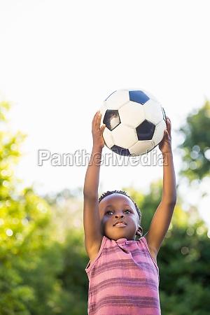 boy is catching a soccer ball