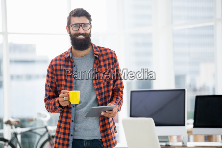 hipster using tablet and drinking coffee