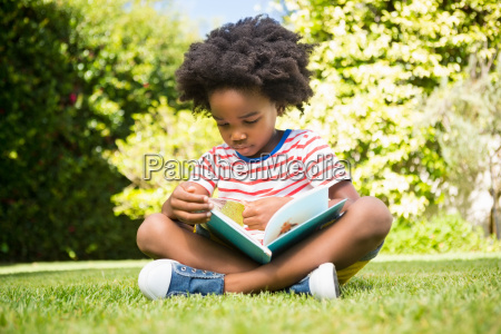 boy reading a book in a