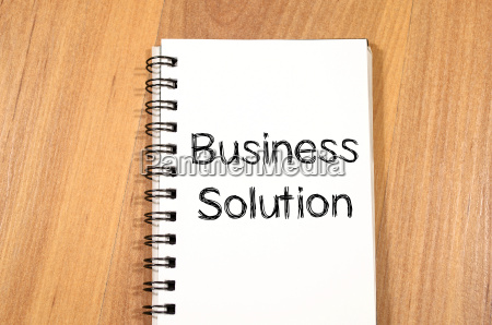 business solution concept on notebook