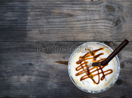 ice coffee on wooden table top
