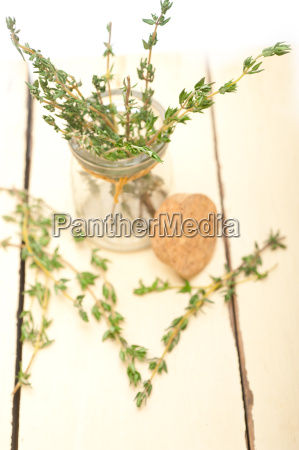 fresh thyme on a glass jar