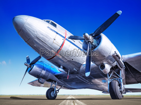 historic airplane on a runway