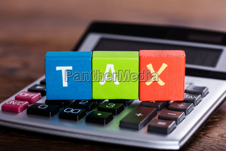 blocks with word tax placed over
