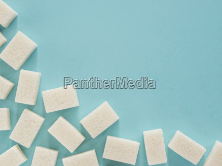 background of white sugar cubes with