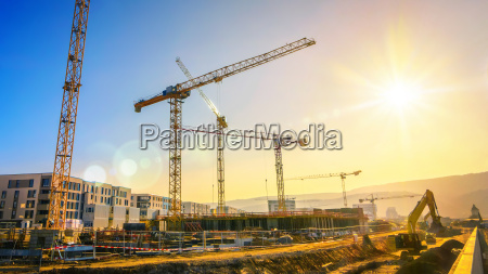 large construction site with several cranes
