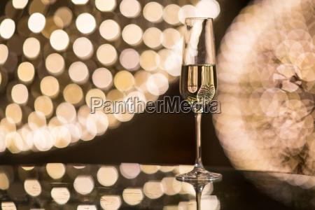 champagne flutes on shiny glassy background