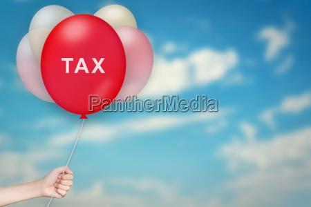 hand holding tax balloon