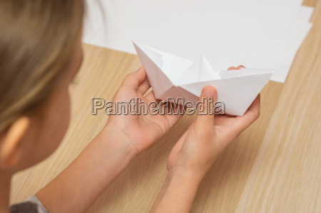 a girl looks at a paper