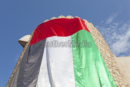 tower with uae flag